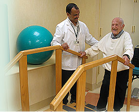 Photo of a Forest Hills doctor helping a resident in rehabilitation